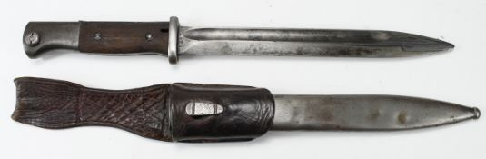 German Army bayonet with metal scabbard and leather frog. Blade marked 'S238 G' and '5453 d'. Waffen