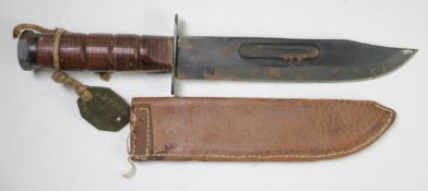 American M1 fighting knife, complete with contemporary replacement leather scabbard, has a WW2 era