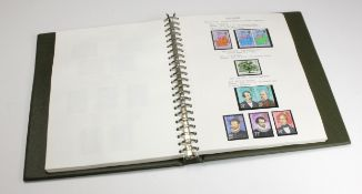 GB - 1924-84 collection of commemorative stamps presented in a luxury padded album, apparently all