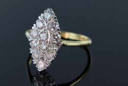 18ct and platinum marquise shaped diamond ring consisting of twelve round brilliant cut diamonds