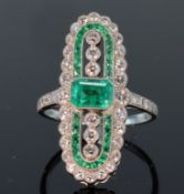 Platinum emerald and diamond Art Deco style lozenge shaped ring set with central emerald cut emerald