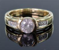 9ct yellow gold ring with principal 6.5mm round brilliant cut diamond in semi rub over setting