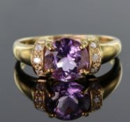 9ct yellow gold rinig set with a round 8mm 1.46ct amethyst highlighted on either side by a group