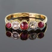 18ct yellow gold graduated five stone ruby and diamond ring with rub over setting, total diamond