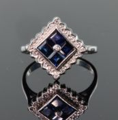 9ct white gold ring set with four princess cut sapphires in an offset square shape, surrounded by
