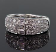 18ct white gold diamond set band ring comprising a centre section set with three emerald cut
