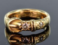 18ct yellow gold 5mm wide band ring with buckle design set with two old cut diamonds in a gypsy