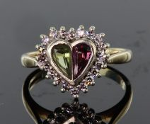 9ct yellow and white gold heart shaped ring set with a pink and green calibre cut tourmaline