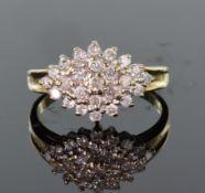 9ct yellow gold diamond cluster ring consisting of twenty five round brilliant cut diamonds