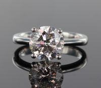 Platinum and diamond solitaire ring comprising a round brilliant cut diamond weighing 3.52ct, set in