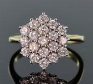 18t yellow gold diamond three row cluster ring consisting of nineteen round brilliant cut diamonds