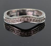 9ct white gold shaped band ring set with fifteen round diamonds in a millegrain setting, total