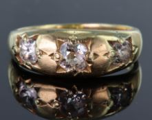 Tests as 15ct yellow gold gypsy set three stone ring set with three old cut diamonds, centre diamond