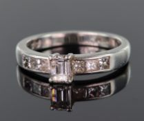 Platinum ring set with central step cut diamond calculated as weighing approx. 0.25ct, with a