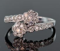 18ct white gold diamond double cluster crossover style ring, each seven stone diamond cluster
