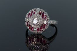 Platinum Art Deco style ruby and diamond ring set with central round brilliant cut diamond,