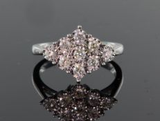 9ct white gold nine stone diamond cluster ring consisting of round brilliant cut diamonds calculated