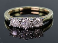 9ct yellow gold ring set with three graduated round brilliant cut diamonds totalling 0.50ct, in an