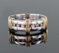 18ct white gold band ring set with seven round brilliant cut diamonds calculated as weighing a total