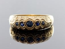 9ct yellow gold flared head band ring set with five graduated sapphires, finger size R-S, weight 3.