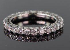 Tests as 18ct white gold diamond full eternity ring set with twenty five round brilliant cut