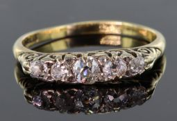18ct yellow gold carved head ring set with five graduating round old cut diamonds, calculated as