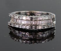 18ct white gold three row diamond ring consisting of central channel set recessed row of baguette