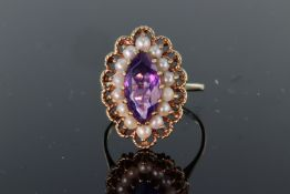 9ct yellow gold ring set with central marquise shaped amethyst measuring approx. 19mm x 7mm,