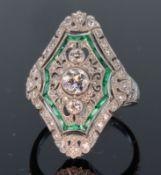 Platinum diamond and emerald Art Deco style large dress ring comprising three round brilliant cut