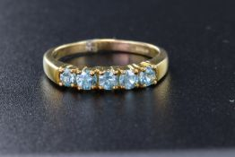 9ct yellow gold half eternity style claw set ring, with five 3mm round Ratanakiri Zircon, finger
