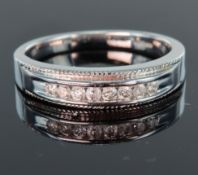 9ct white gold half eternity ring set with eight round brilliant cut diamonds totalling 0.24ct in