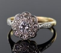 18ct yellow gold and platinum diamond daisy cluster ring consisting of central round brilliant cut