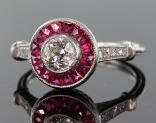 Platinum diamond and ruby ring consisting of central round brilliant cut diamond calculated as