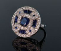 18ct white gold large circular sapphire and diamond dress ring consisting of a central round