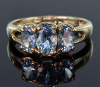 9ct yellow gold ring set with three graduated Santa Maria aquamarine stones, totalling 1.259ct,