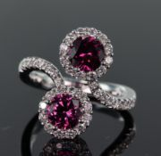 18ct white gold double cluster crossover design ring set with two round pink tourmaline measuring