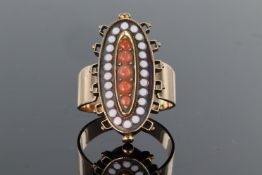 9ct yellow gold elongated oval dress ring set with raised central panel of five graduated coral
