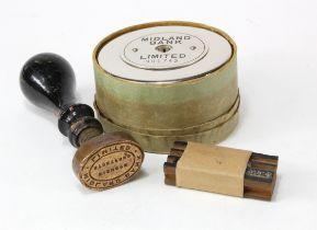 Bank stamp (2) and Money Box, Midland Bank Bishop Stortford branch, wooden handle with brass