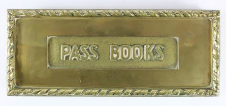 Brass letter box 'PASS BOOKS' probably original from a building society branch, mounted on wooden
