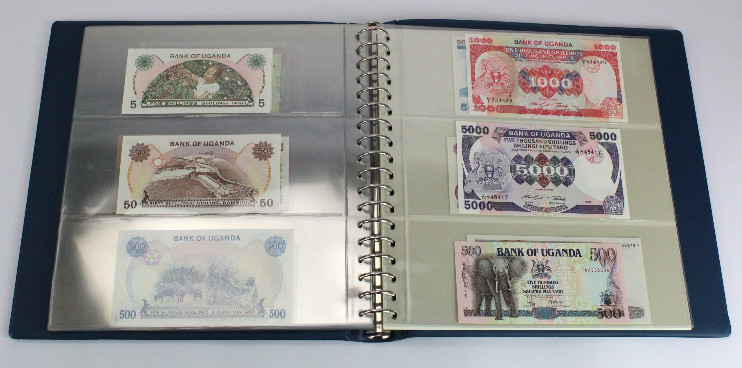 World, Africa (76) a good group of Uncirculated notes in Lindner album, Biafra, Gambia, Ghana, - Image 24 of 27