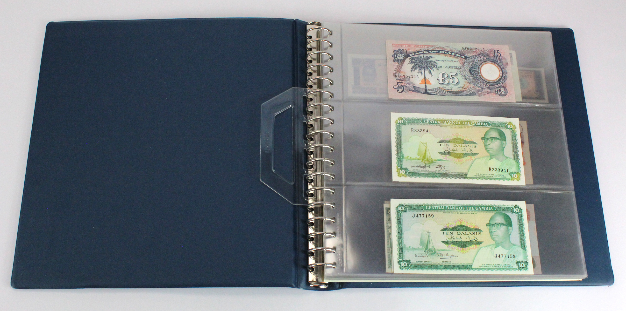 World, Africa (76) a good group of Uncirculated notes in Lindner album, Biafra, Gambia, Ghana,