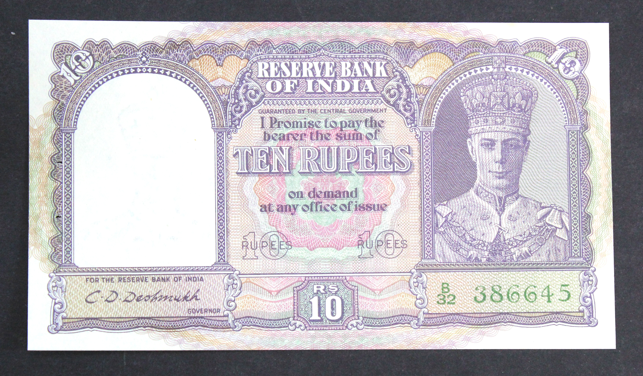 India 10 Rupees issued 1943, King George VI portrait at right, signed C.D. Deshmukh, serial B/32