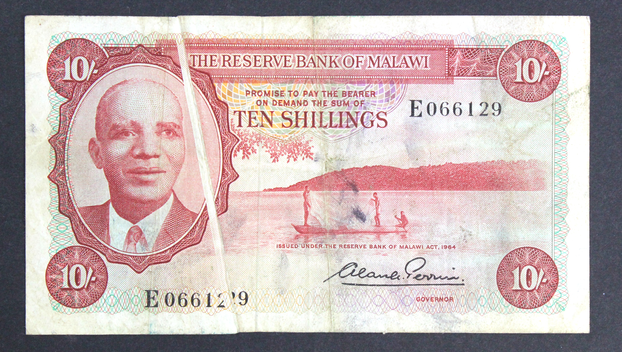 Malawi 10 Shillings ERROR note dated 1964, a strong GUTTER FOLD error, rare first issue signed