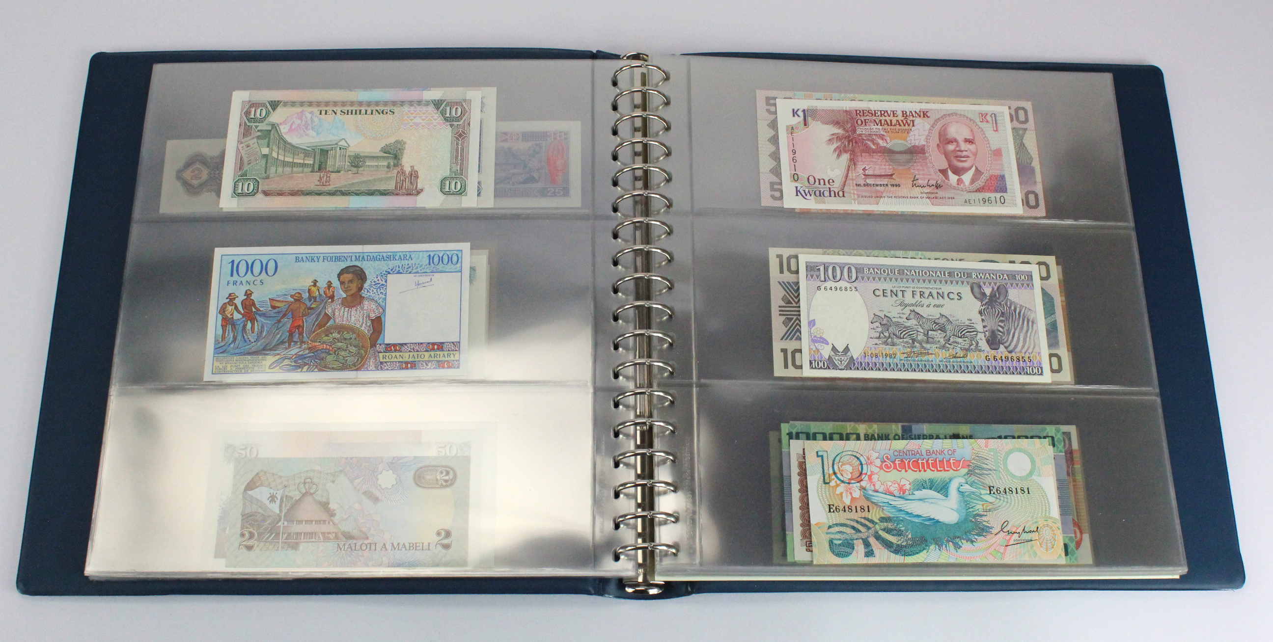 World, Africa (76) a good group of Uncirculated notes in Lindner album, Biafra, Gambia, Ghana, - Image 11 of 27