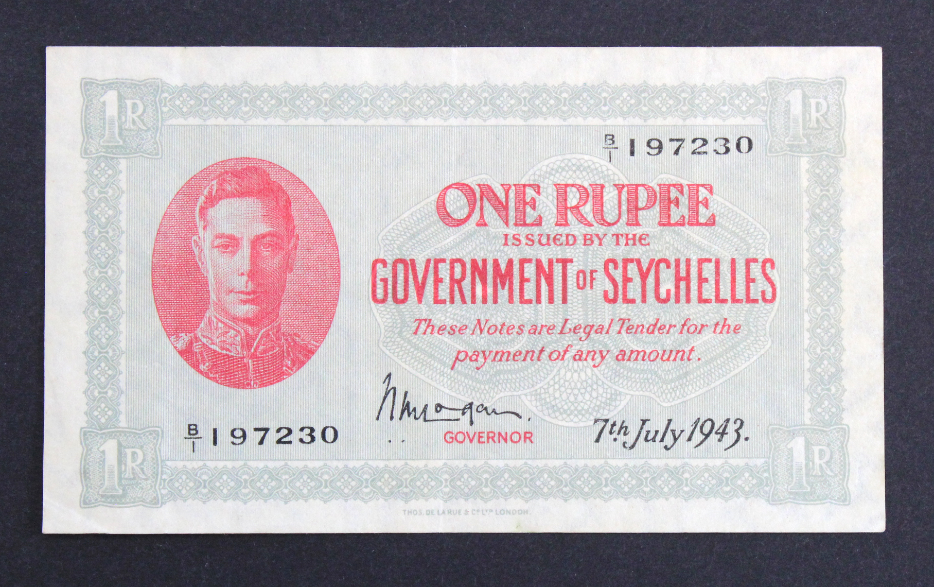 Seychelles 1 Rupee dated 7th July 1943, portrait King George VI at left, signed W.M. Logan, serial