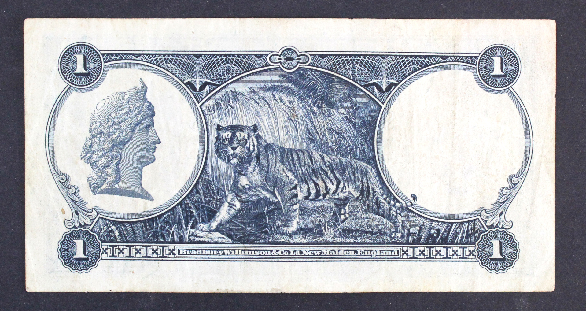Straits Settlements 1 Dollar dated 1st January 1935, portrait King George V at right, serial L/55 - Image 2 of 2