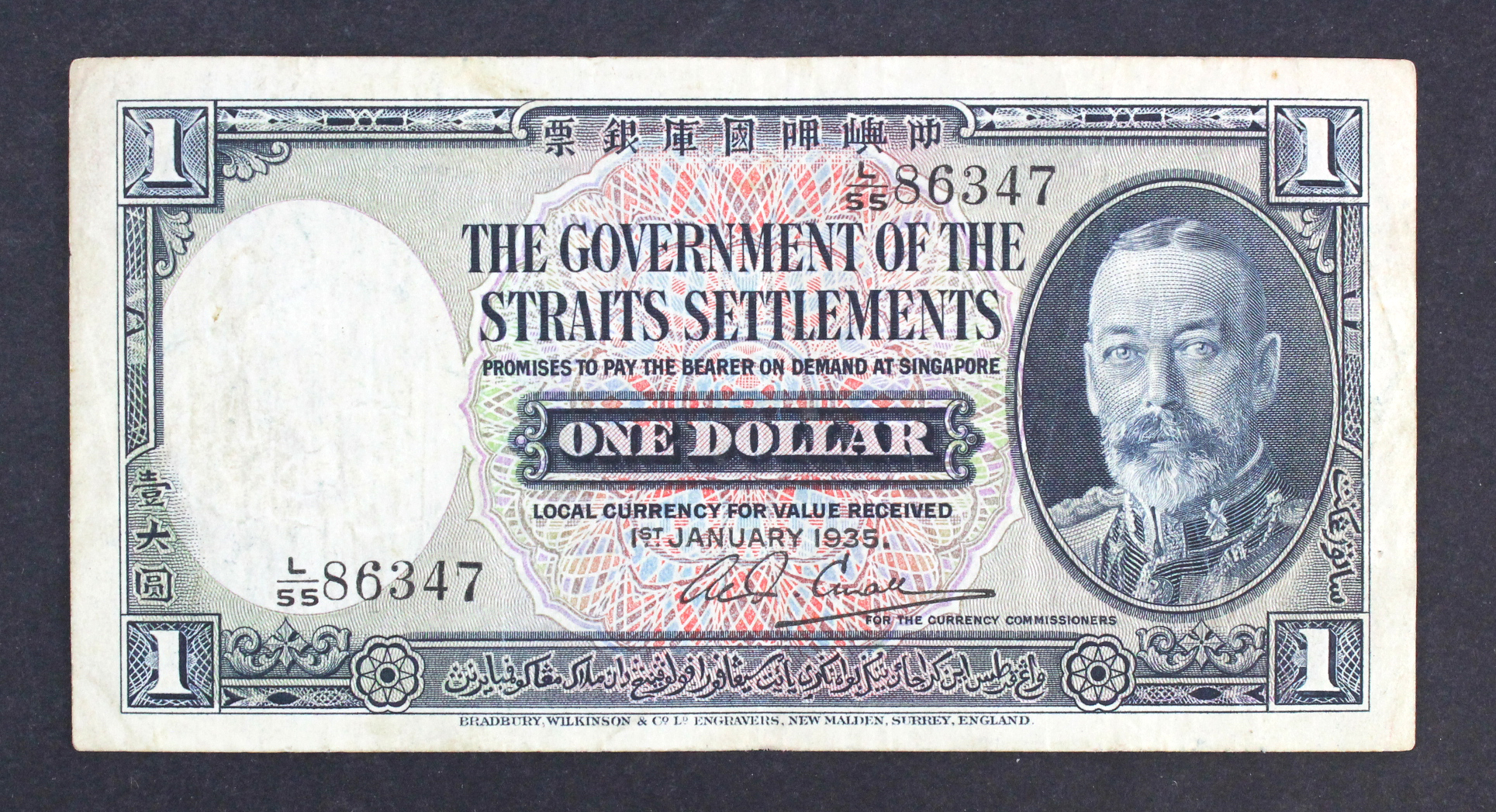 Straits Settlements 1 Dollar dated 1st January 1935, portrait King George V at right, serial L/55