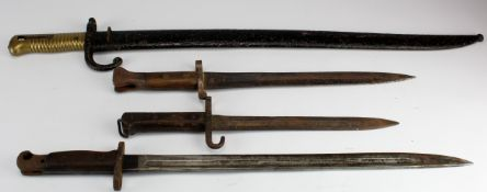 Bayonets - 1) French M1866 made at St Etienne in 1870, scabbard and cross guard heavily pitted,