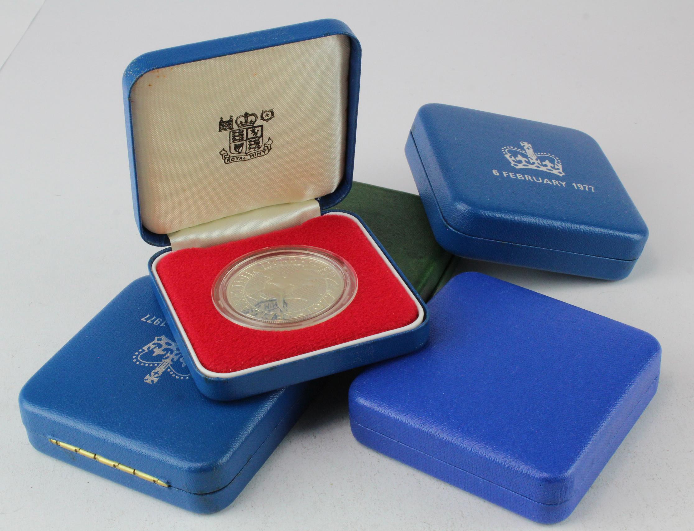 UK Silver Proof Crowns (5): 1972 Silver Wedding - loose in box; 1977 Jubilee x3; 1999 Millennium;