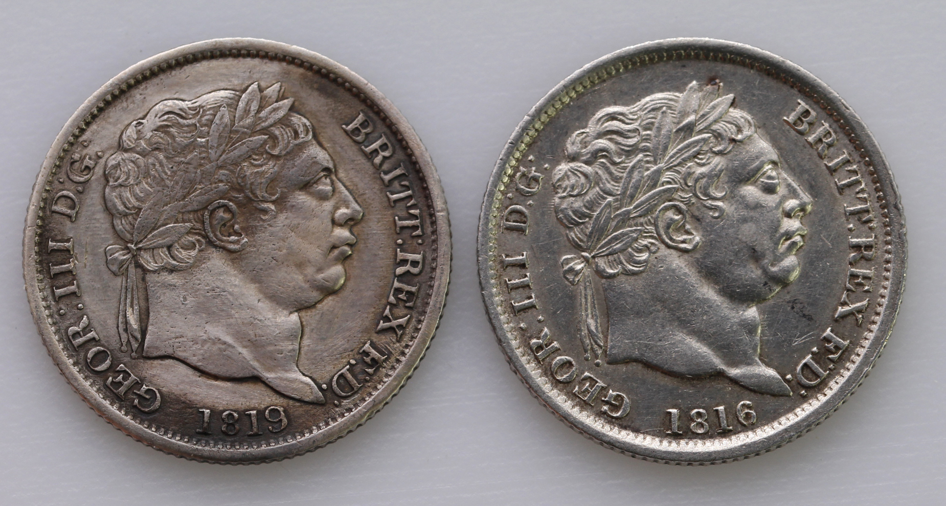 Shillings (2): 1816 aEF and 1819/8 cleaned VF